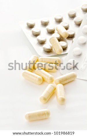Pills and capsules isolated on a white background