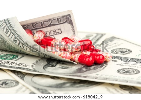pills and money isolated on a white background