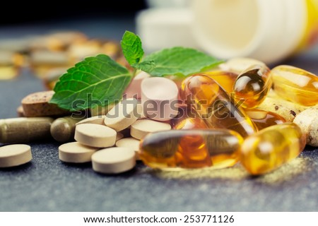 pills and multivitamins on a dark background, closeup Stock photo ©