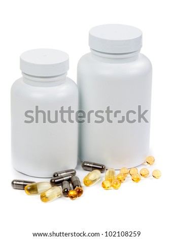 Pills and two bottle on the white