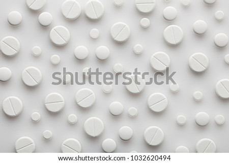 pills background, tablets on a white background #1032620494