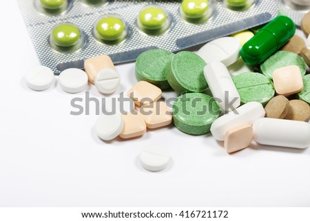 Pills close up on a light background. Medications. A variety of medications. #416721172