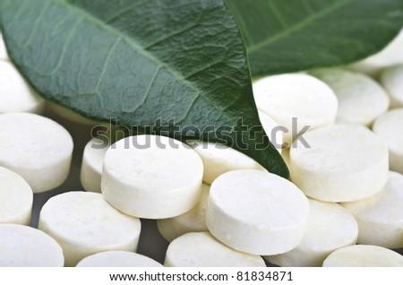 Pills closeup on the leaf - stock photo