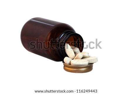 pills coming out of bottle isolated