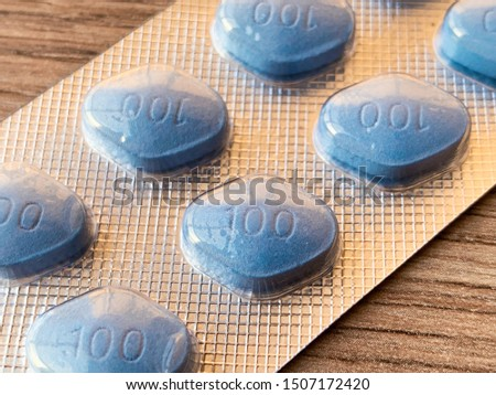 Pills for men's sexual health on table