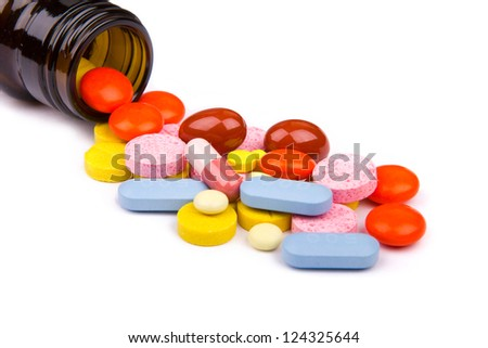 Pills from bottle on the white