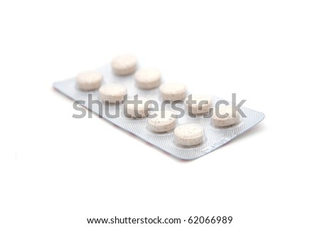 Pills, image is taken over a solid white background