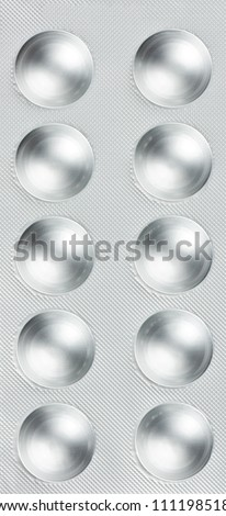 Pills in blister packs as a background