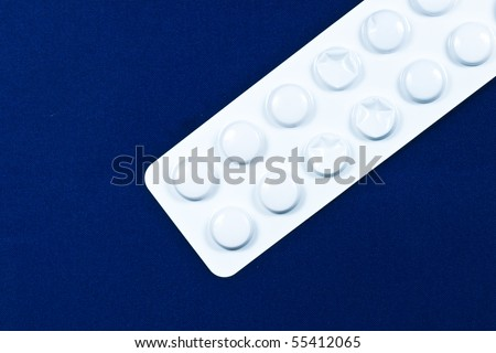 Pills in blisters with blue background