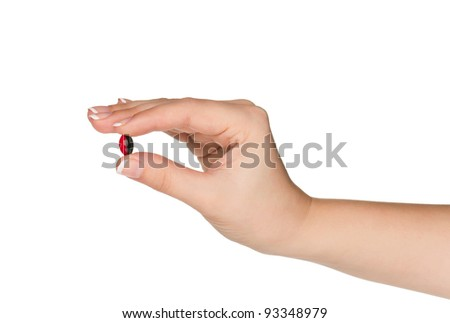 Pills in woman hand isolated on white background