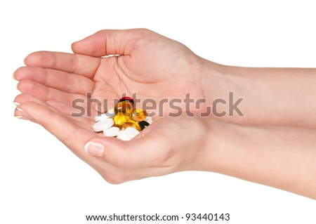 Pills in woman hands isolated on white background - stock photo