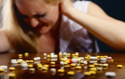 Pills lying on the table before suffering from the pain the young woman