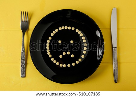 stock-photo-pills-on-a-plate-in-form-of-