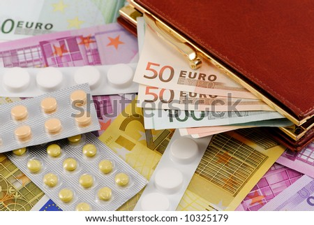 Pills on European currency. Concept of medicating an injured economy, or concept of the cost of medication