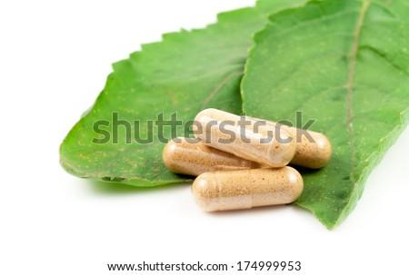 Pills on green sheet