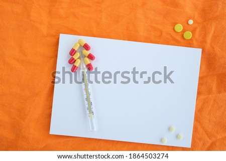 Pills on orange background, conceptual medical background with copy space. High quality photo Zdjęcia stock ©