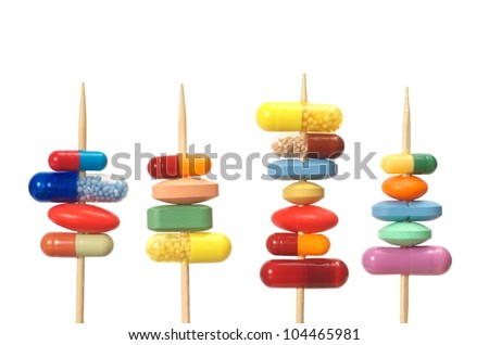 Pills on toothpicks isolated on white background