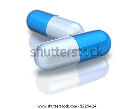 Pills over white reflective background