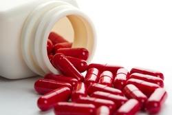 Pills spilling from an open bottle