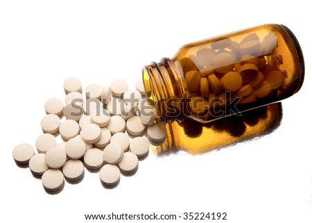 Pills spilling from bottle