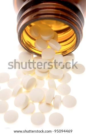 Pills spilling from bottle closeup
