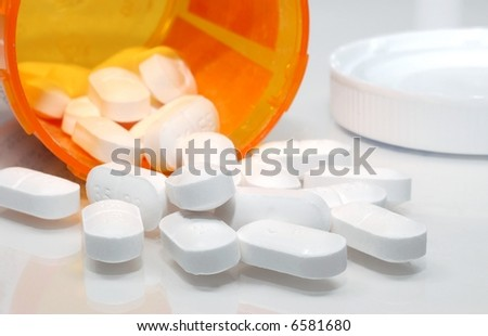 Pills spilling out from a prescription bottle