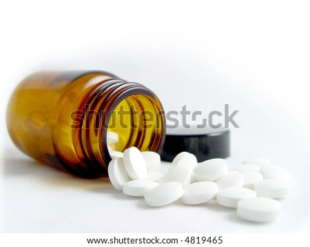 Pills Spilling out of Pill Bottle