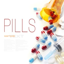 Pills spilling out of pill bottle and Syringe isolated on white (with sample text)