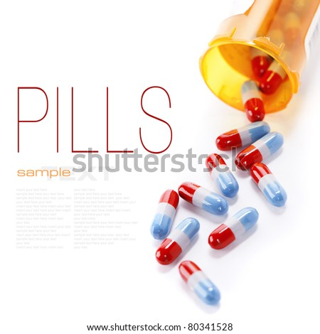 Pills spilling out of pill bottle isolated on white (with sample text) - stock photo
