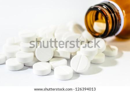 Pills Spilling out of Pill Bottle Shallow DOF