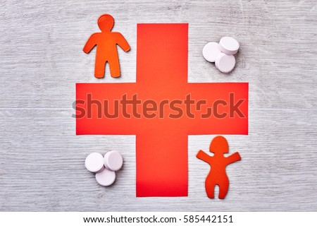 Pills, stickmen and red cross. Advertisement of new diagnostical center.