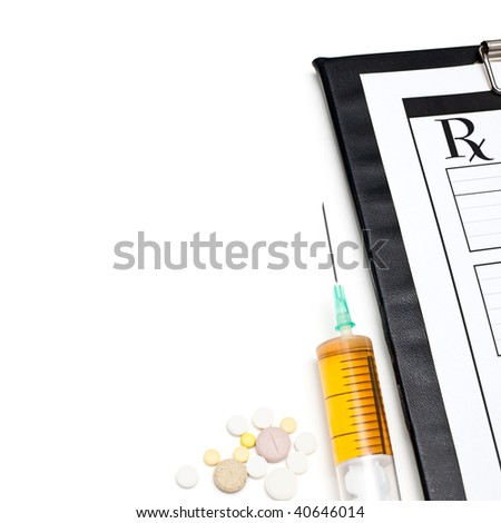 Pills syringe and clipboard on white background