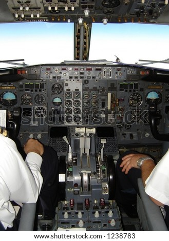 Pilot and copilot operating boeing 737 plane - inside cockpit