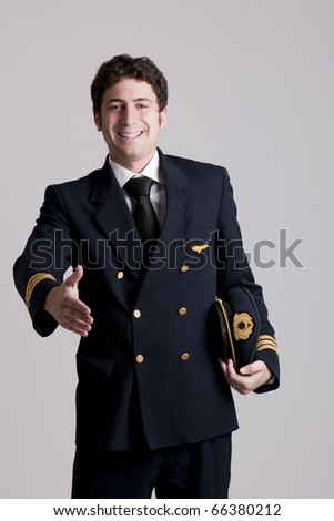 Pilot giving hand for shaking
