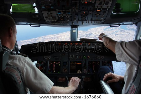 Pilot in cockpit - stock photo