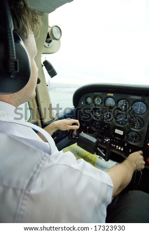 Pilot in cockpit flying an airplane