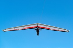 Pilot on modern high performance hang glider. Aviation athlete.