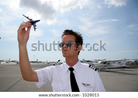 Pilot playing with toy airplane