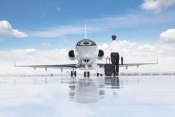 Pilot walking towards private jet