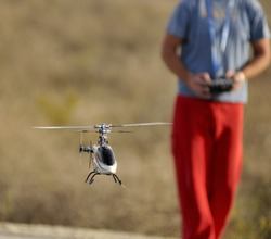 Piloting Radio controlled helicopter with remote control