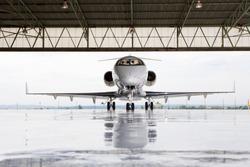 Pilots in private jet in hangar