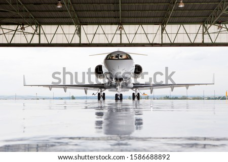 Pilots in private jet in hangar