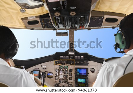 Pilots in the plane cockpit and blue sky