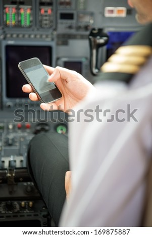 Pilots using smartphone in cockpit of private jet #169875887