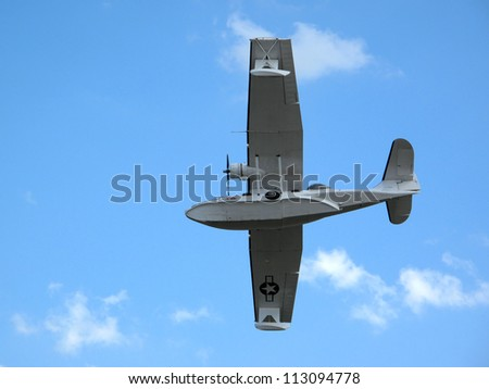 "PILSEN, CZECH REPUBLIC - AUGUST 26: Consolidated PBY-5A Catalina ""Miss Pick Up"" in flight on blue sky, Pilsen airshow on August 26, 2012 in Pilsen, Czech republic."
