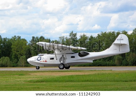 "PILSEN, CZECH REPUBLIC - AUGUST 26: Consolidated PBY-5A Catalina ""Miss Pick Up"" landing at airfield, Pilsen airshow on August 26, 2012 in Pilsen, Czech republic."