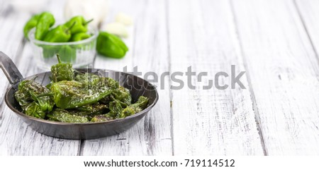 Shutterstock Pimientos de Padron on rustic wooden background as close-up shot