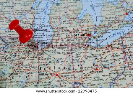 Pin pointing on Chicago on USA map in atlas