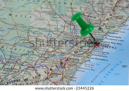 Pin pointing on Sydney on map in atlas