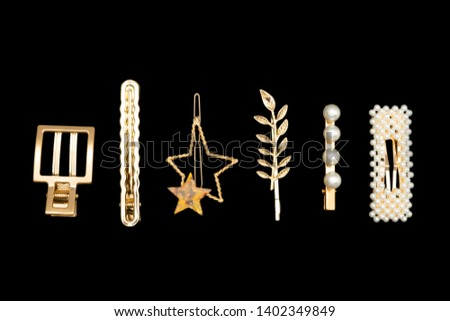 Pin set beauty trendy accessories hair pearl clip on black background. Top view. Copy space fot text.  Stockfoto ©